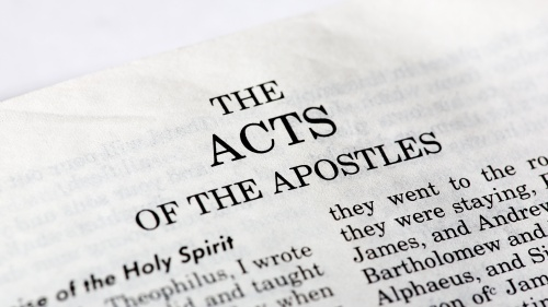 Bible opened to the book of Acts.