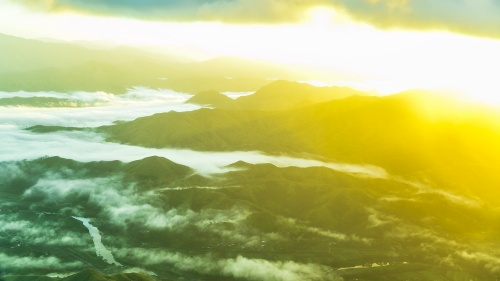 A sun glare over a valley.