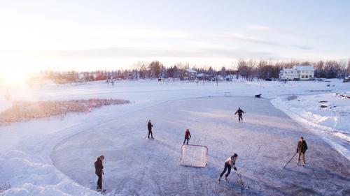 People playing hockey outside.