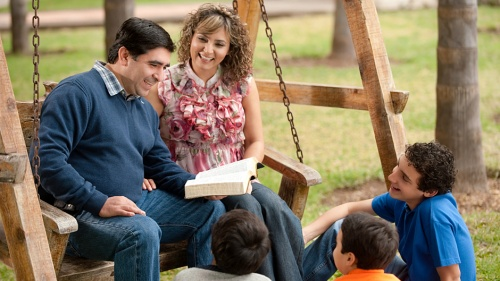 A family reading the Bible together.