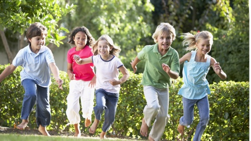 A group of young kids running.