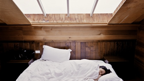 A person sleeping in a bed.