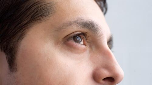 A close up of a man's face.