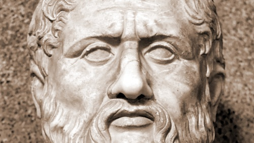 A bust of Plato's face in stone.