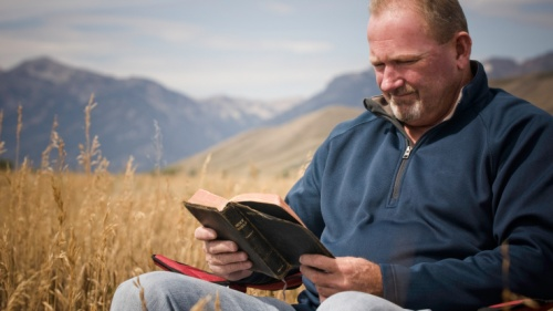 A man reading a Bible.