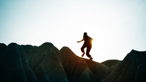 A person running up a mountain.