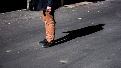 Shadow of a person's legs.