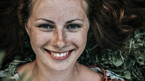 Upclose photo of a young woman face.