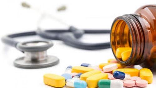 A spilled bottle of medication/pills.