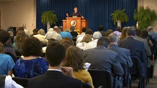 A church congregation listening to a sermon.