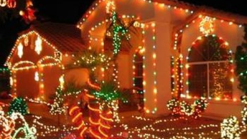 House lit up with lots of Christmas lights.