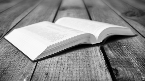 A open Bible laying on a table.