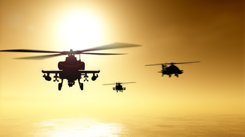 Military helicopters flying over water.