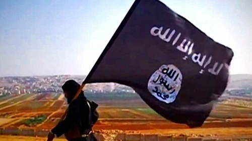 A man carrying a ISIS flag.