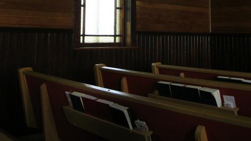 Pews inside a church.