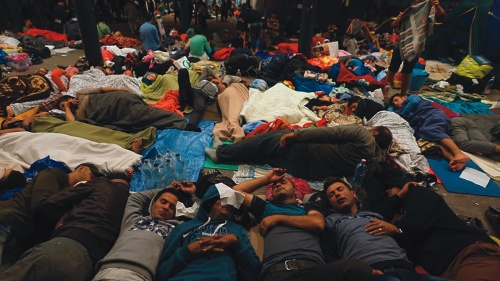 Syrian refugees sleep on the floor of a railway station in Hungary.