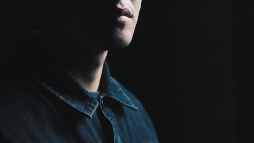 An upclose photo of a man's face.