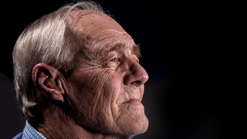 An older man looking away from the camera.