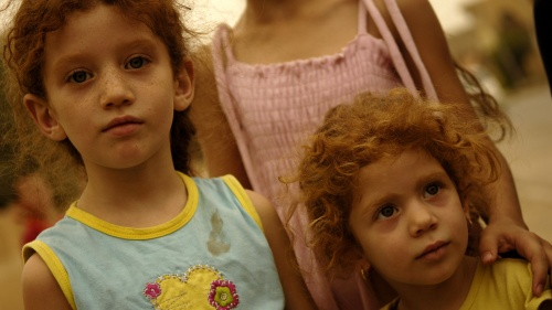 A young Iraqi girl and her sister in the Christian village of Qaraqosh, outside of Mosul, Iraq.