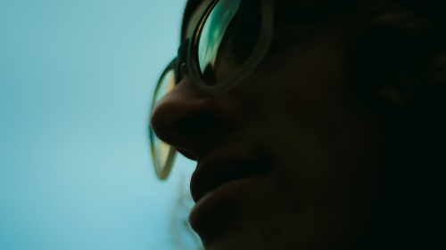 Upclose photo of a person wearing glasses.