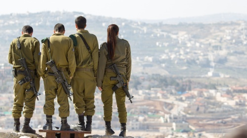 Soldiers in Israel overlooking a valley new Gush Eziyon.