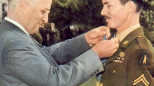 President Harry Truman awarding the Medal of Honor on conscientious objector Desmond Doss.