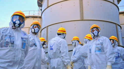A team of IAEA experts check out water storage tanks.