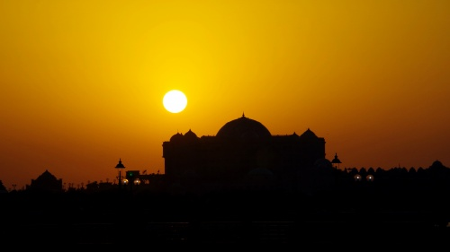 A sunset over a Muslim mosque.