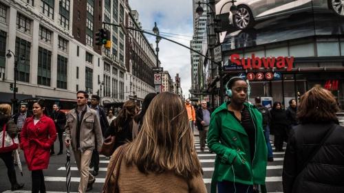 People walking in a busy city.
