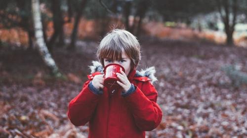 A little boy from a camp mug.