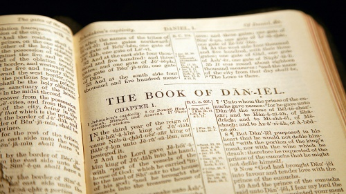 A Bible opened to the book of Daniel.