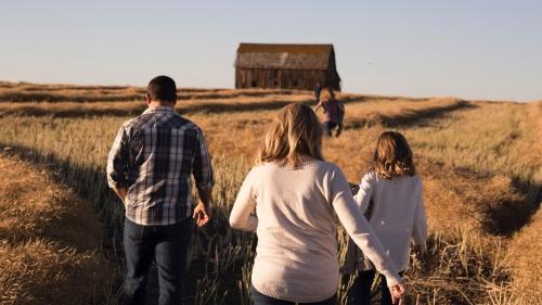 A family walking in a field.