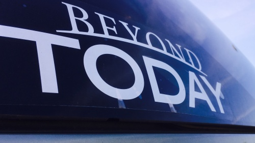 Beyond Today bumper sticker on a car window.