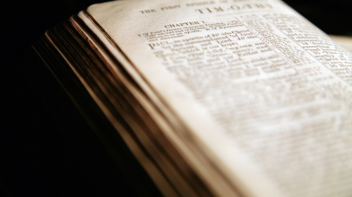 A Bible opened to the book of Timothy.