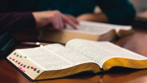 Open Bibles laying on a table.