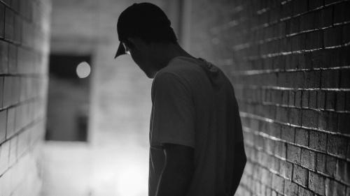 A man in a dark hallway.