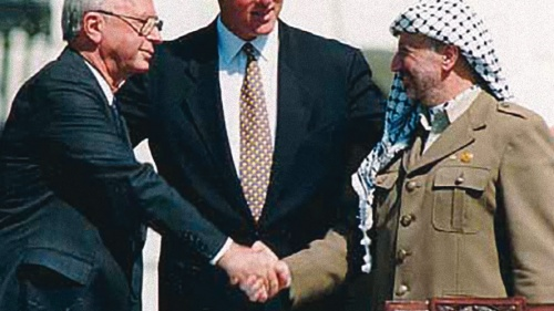 Israeli Prime Minister Yitzhak Rabin, U.S. President Bill Clinton and Yasser Arafat at the Oslo I Accord signing in 1993.