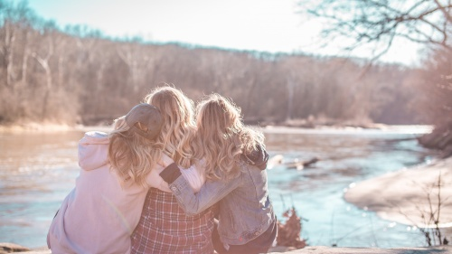Friends hugging each other.