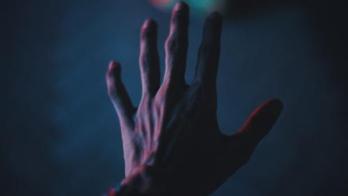 A hand reaching.