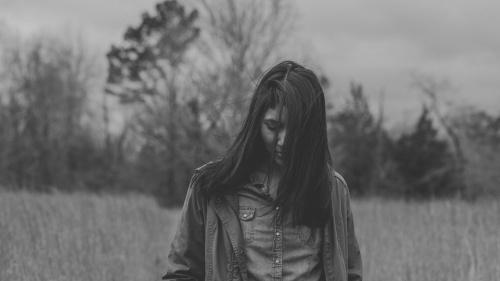A woman walking in a field.