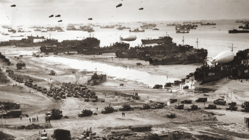 With the Normandy beachhead secured, vast numbers of Allied troops and military vehicles flood ashore.