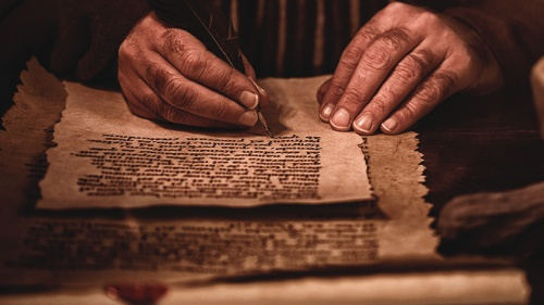 A photo illustration of man writing in a scroll.