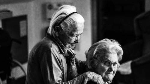 Two elderly women beside each other.
