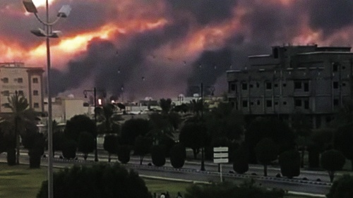 A Saudi oil facility burns after an Iranian attack.