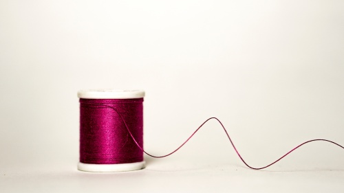 A spool of thread unraveling.