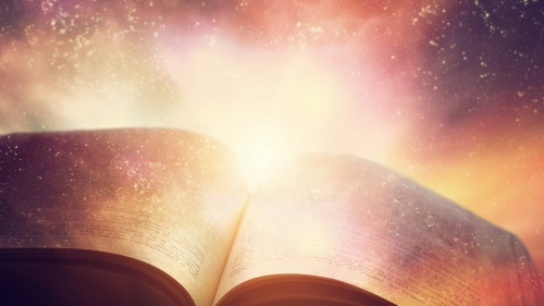 An open book/Bible with light around it.