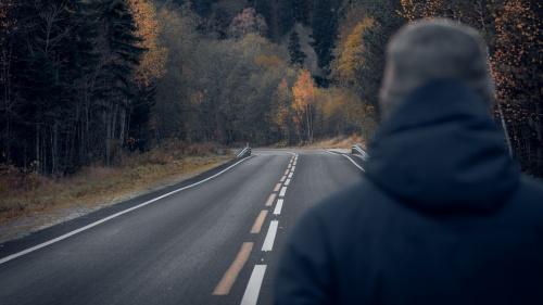 A man looking at a road.