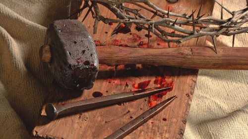 Old hammer, nails and thorns.
