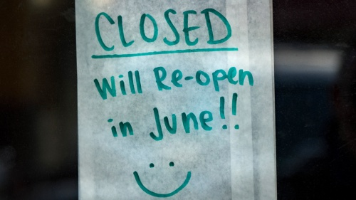 A handwritten note on business store door that its closed till June.