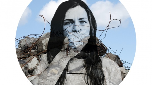 Girl with hand over her mouth superimposed on broken wall exposing rebar